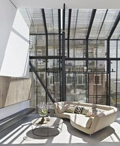 Magnificent high ceiling with natural ray and designer sofa!