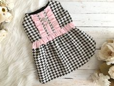 Simply gorgeous! This Chanel inspired, houndstooth print dress is an elegant addition to your fur babys collection. Accented with pink ruffles and a pearl/ rhinestone tiara button. Harness comes with a D-ring and Velcro closure on neck and belly.  Check out this gorgeous Chanel Inspired houndstooth harness. https://www.etsy.com/listing/478337304/chanel-houndstooth-dog-harness-puppy  ::::::: Please be advised that there is no standard sizing system for pet clothin...