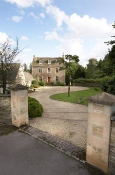 Transition from black top drive to gravel at entry with brick…Beautiful English Country Manor