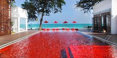 Red tiled pool Thailand. Looks hot! Pinned to Pool Design by Darin Bradbury of BASK Pool Design.