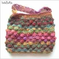 "This Versatile Beautiful Crocheted Handmade Handbag will compliment any outfit.  100% HANDMADE.  Measure approx.: 10.2"" inches long (not counting the straps) 16"" inches long (counting the straps) 11""- 11.8"" inches wide  I try to represent the true colors, however, colors may vary due to ..."