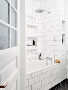 Black and white bathroom design with lots of built in tile storage cubbies // Scandinavian interior of an art lovers dream Bathroom Renos, White Bathroom, Bathroom Interior, Small Bathroom, Master Bathroom, Budget Bathroom, Tile Bathrooms, Bathroom Ideas, Shower Ideas