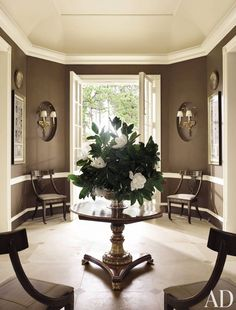 Traditional Entrance Hall by Richard Keith Langham, Inc. and Lewis Graeber III & Associates in Hattiesburg, Mississippi