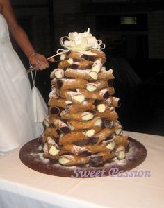 Canolli display instead of cake or cupcakes  Love this New York     Canolli display instead of cake or cupcakes  Love this New York bride    wedding  weddingcakes   Wedding Cakes   Pinterest   Display  Wedding and  Cake