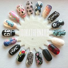 Another nail art wheel with everything from floral prints, to fashion inspiration, lace, watercolor, text, and some matte mixed in. by LookAtHerNails