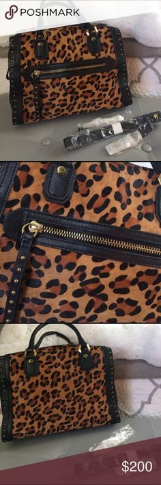 Cheetah and leather Oryany handbag Like new condition bag, no scratches. Originally priced at $535. Stunning bag. Comes with shoulder strap. oryany Bags