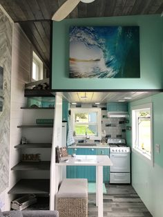 The beach theme carries into the home with sea green wall panels and kitchen cabinets.