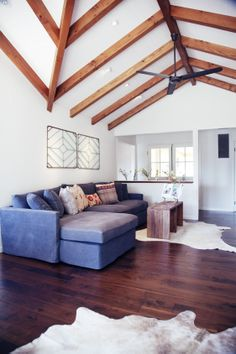modern farmhouse living room. Pitched ceilings.  Exposed beams.  Interior Design by @Kress Jack at Home