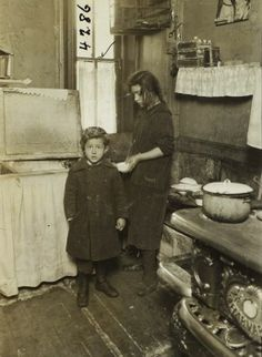 """SISTER and BROTHER: """"New York: Tenement families. Early 1900s."""" Photography by Jessie Tarbox Beals (1870-1942)."""