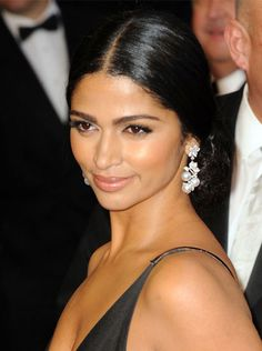 For a more traditional route, opt for a middle-parted sleek chignon like the one Camila Alves wore to the 2011 Oscars.