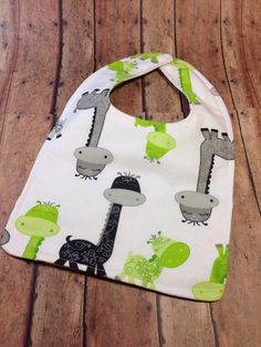 This listing is for one personalized baby bib. This would make a great shower gift or new mommy/grandma gift. The front is in an adorable giraffe print and a grey, green and black dot print. The back is the giraffe print. There is a layer of absorbent flannel in the middle. The rick