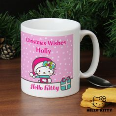 Personalise the front of this Pink Christmas Hello Kitty Mug with 2 lines of text.  #ChristmasGifts