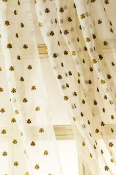 Bee-embroidered silk organza curtains - I love these. I found the picture on Pinterest linked to a sold-out, and slightly suspicious, Amazon listing, and I can't find them anywhere else, but I'd look for something similar.