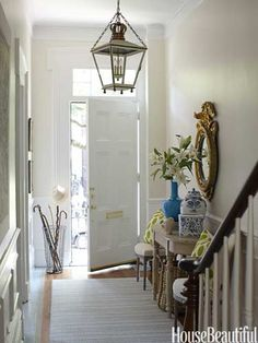 Circa Lighting's hanging lantern. Designer: Lynn Morgan. Photo: Christoper Baker. housebeautiful.com  #lantern #entryway