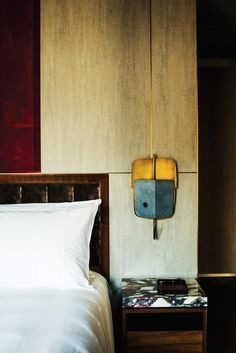 <strong>ROOM SERVICE</strong>   Architect Marco Costanzi designed the seven-room hotel, where each suite is slightly different. Above each bed is a framed panel of Fendi fur.