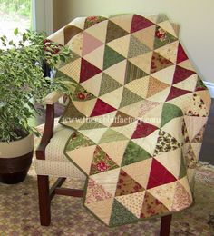 """""""Trouble Free Triangles"""" from the Rabbit Factory (was a limited time offer for the free pattern, through 10/1/14... which I did, btw)... would be a good way to try my hand at a triangle quilt"""