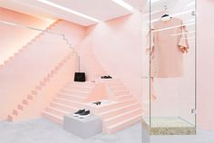 Who would have thought that the pink color in retail, could become the color-muse of brands so different from each other? Discover this incredible shade! Anagrama, Novelty store in New York | pink store | pink walls | pink retail store | commercial architecture | new store | new york stores | new york boutiques | interior architecture | fashion store | clothing store | pink boutique | brand new store | pink stairs | marble pedestal | glass box
