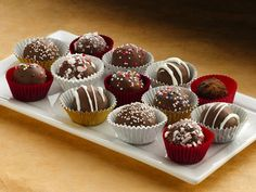 Holiday Cake Bon Bons  Bite-sized bliss! Cake ball bon bons are a snap to make using cake mix and frosting and are an instant hit on any dessert tray.