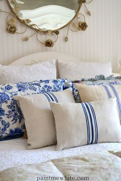 The pillows mixed with pattern for cutains on natural quilt for master bedroom - Paint Me White: French Grainsack Cushions Now In Stock