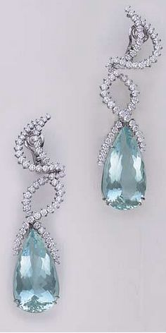 MARGHERITA BURGENER A Pair of Aquamarine and Diamond Ear pendants,  Signed 'Margherita Burgener'.  ...Each crescent-shaped circular-cut diamond surmount, extending undulating circular-cut diamond ribbons, suspending a pear-shaped aquamarine, mounted in18K white gold...