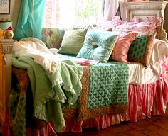 Colorful spread and pillows on the bed.