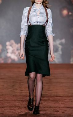 """With a collection appropriately named """"The Brits"""", the Austrian designer pays homage to national icons including the Queen and infamous literary characters, Miss Marple and Sherlock Holmes. But the collection is anything but cliché. A series of well-to-do tweeds and earthy florals create elegant looks perfect for channeling your inner English rose."""
