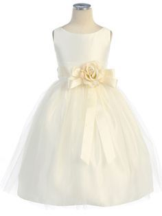 Lovely Tulle Overlay and a precious removal sash with detachable floral pin put the sweetest finishing touches on this twirl perfect dress. This tea length style makes for easy dressing with its hidde