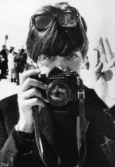 Paul McCartney w/Camera in mid 1960s -- is that a 'Peace Sign' w/his fingers? or a boy scout pledge salute? ;-)