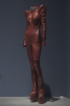 Hogan McLaughlin, vintage jumpsuit and modified Nina Ricci boots in brown leather and rhinestones. Fashion Institute of Technology - Daphne Guinness Exhibition