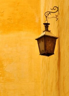lanterns hanging on the wall, lighting up the street with tiny blobs of yellow after dark. Mellow Yellow, Bright Yellow, Mustard Yellow, Shades Of Yellow, Yellow And Brown, Foto Art, Yellow Submarine, Yellow Walls, Street Lamp