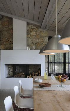 Hanging light fixtures and reclaimed wood table. Great use of natural elements and polished silver really gives this space a contemporary feel.