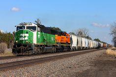 BNSF 8185 West -  thought I was done for the day, when I received a tip from Lasko about the 8185 heading west. I quickly looked outside to see full sun and then I was out the door. I didn't have to wait long in Big Lake for this guy to show up. A short chase to MP 67, where my last shots were taken. M-NTWLAU with a 60M and a GP50 head west on a fine April evening.