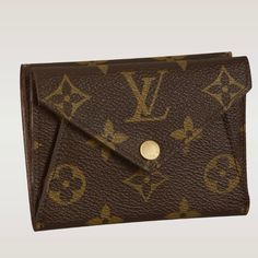 - Grained calf leather and Monogram canvas lining  - Shiny golden brass hardware  - One exterior gussets compartment  - Eight credit card slots  - Two interior gusseted compartments, one for coins, one for receipts