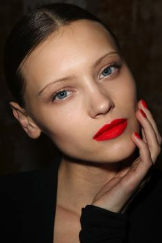 Love this - simple look. Julien David uses orange-red lipstick at Paris Fashion Week, Mar 2012 . Very minimal eyes and no obvious blush.