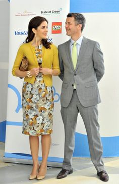 Crown Prince Frederik of Denmark and Princess Mary both fashionable in yellow.