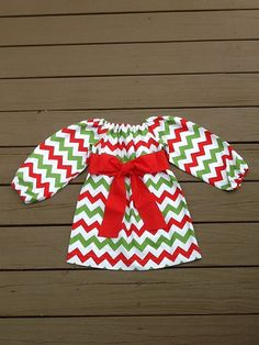 Girls Christmas peasant Dress & sash detail. Red green white Christmas chevron. Red fabric sash. Your choice sleeve. By EverythingSorella on Etsy, $32.50