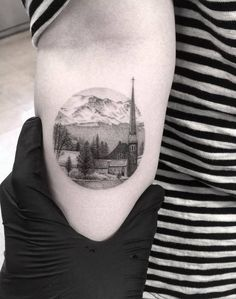 Fine line style landscape circle tattoo of a small town in colorado. Artista Tatuador: Dr. Woo