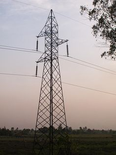 An electric transmission pylon in the countryside, carrying high tension wires. These towers, because of their size, dominate the otherwise featureless countryside