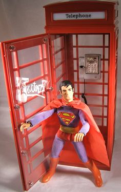 Mego Superman action figure comes out of a phone.