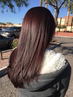 Brown hair with a pop of red violet !                                                                                                                                                     More