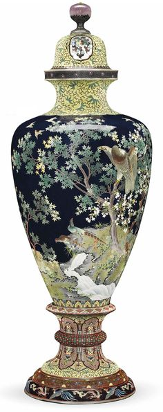 An Impressive Cloisonné Vase Mark of Hayashi Tanigoro Workshop, Meiji period (late 19th century) Of baluster form, worked in silver wire and decorated in various coloured enamels with a hawk in maple and cherry blossom trees and two pheasants beside a stream on a deep blue ground. Silver rims. 61.5cm. high. Christies 2013 - £31,250.