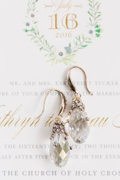 Sparkly Drop Earrings Against Garden-Inspired Invitation | French Blue, Lavender + White Daniel Island Club Wedding by Charleston wedding photographer Dana Cubbage Weddings