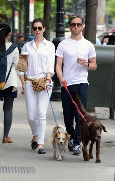 Anne Hathaway pairs her black loafers with an all-white look and a leopard fanny pack