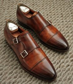 A pair of double monk strap shoes is a must this season.  Get a pair -- These are Santoni, probably about $500