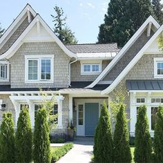 10 Ways to Bring Charm to Your Home's Exterior [With Images] We love doing shingle style homes! 10 Ways to Bring Charm to Your Home's Exterior [With Images] We love doing shingle style homes! Craftsman Home Exterior, Cottage Exterior, House Paint Exterior, Exterior House Colors, House Siding, House Shingles, Exterior Homes, Hamptons Style Homes, Shingle Style Homes