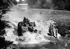 As the British advance swept on over the River Noireau and beyond. The Germans pulled out quickly, leaving the villages untouched by the ravages of war. British self-propelling gun plunges through a stream in pursuit of the fleeing Germans, in France, on August 20, 1944.