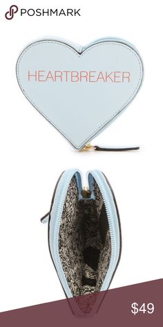 """Rebecca Minkoff Heartbreaker Pouch This whimsy pouch makes a sweet gift for a friend (or for yourself). Use it to store your makeup or loose jewelry.  Color: Icy Blue  Genuine leather 5"""" H x 5.5"""" W x 1"""" D Custom light gold hardware Main zip closure Exclusive leopard print lining.                                 SOLD OUT online & in stores. Brand New with tags attached. Rebecca Minkoff Bags Clutches & Wristlets"""
