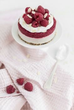 creamy cardamom rasberry cake with coconut whipped cream