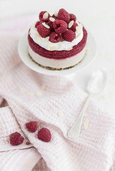 creamy cardamom rasberry cake with coconut whipped cream
