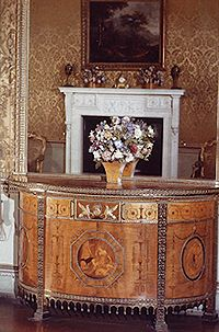 "The ""Diana"" demi-lune commode veneered with satinwood and harewood. Designed by Robert Adam for the drawing room at Osterley Park. Cabinet Marker ? Possibly John Linnell"